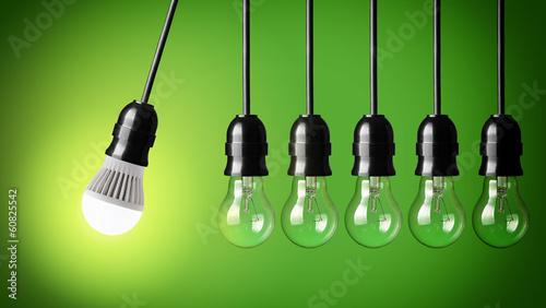 Leinwandbild Motiv Perpetual motion with LED bulb and simple light bulbs