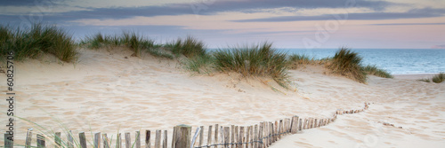 Canvas Zee / Oceaan Panorama landscape of sand dunes system on beach at sunrise