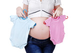 Pregnant woman choosing bodysuit for a baby girl or boy