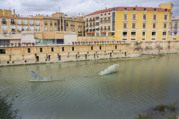 graceful sculpture of a big fish in the river, Murcia, Spain