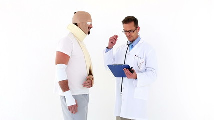 Doctor talking to very injured patient