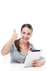 Woman with thumb up and digital tablet