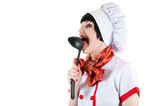female cook with pleasure licking ladle poster