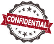 CONFIDENTIAL red grunge vintage seal isolated on white
