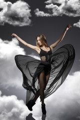 girl with creative fluttering dress