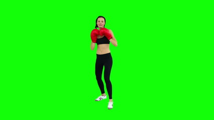 Fit brunette boxing with red gloves