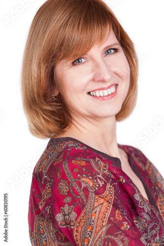 pretty mature woman smiling against white background.