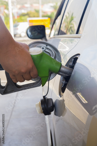 refilling car with fuel close up