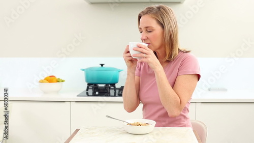 Mature woman drinking coffee at breakfast