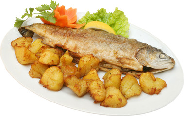 Grilled fish on BBQ with potatoes and vegetables