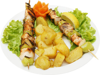 Grilled Fish spits with potatoes and fresh vegetables