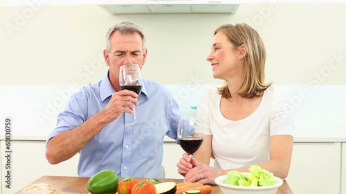 Mature couple drinking red wine together