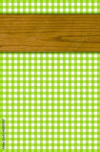 Leinwandbild Motiv Tischdeckenmuster grün weiß mit Holzbrett