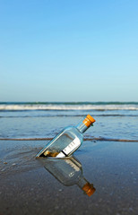 Message in a bottle on the beach