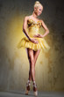 Beautiful ballerina in yellow tutu indoors