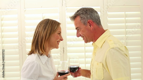 Romantic mature couple drinking red wine
