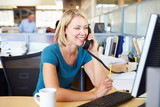 Woman On Phone In Busy Modern Office - 60832770