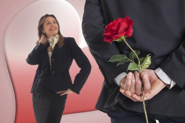 business man gives a rose to his girlfriend