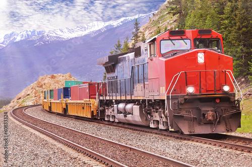 Leinwanddruck Bild Freight train in Canadian rockies.