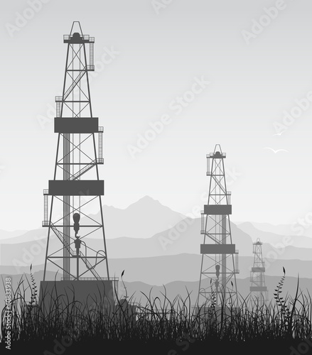 Landscape whith oil rigs over mountain range.