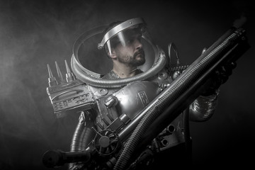 Cosmonaut, Astronaut on a black background with huge weapon.