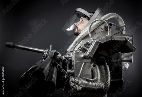 Spaceman, Astronaut on a black background with huge weapon.