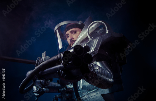 Galaxy, Astronaut on a black background with huge weapon.