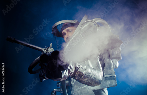 Pressure, Astronaut on a black background with huge weapon.