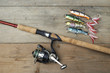 colorful lures with the fishing rod on the wooden pier