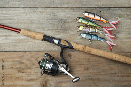 Fotobehang Vissen colorful lures with the fishing rod on the wooden pier