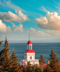 Typical red buildings of Tadoussac, Quebec - Canada
