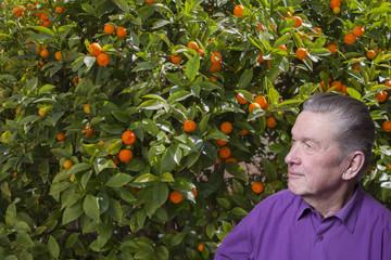Senior man in oranges.