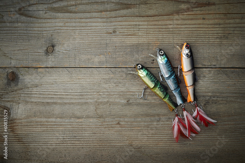 Staande foto Vissen colorful lures on the wooden pier