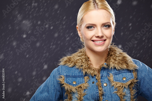 Blonde woman in jeans jacket with fur