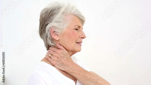 Injured patient rubbing her neck