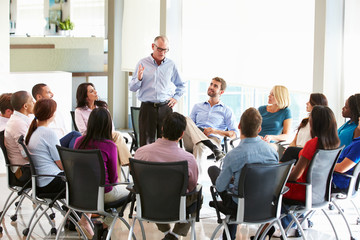 Businessman Addressing Multi-Cultural Office Staff Meeting