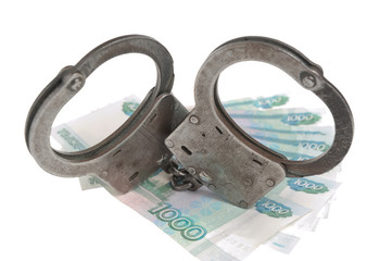 Handcuffs and russian money isolated