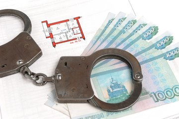 Handcuffs, money and technical passport with the plan of the apa