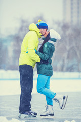 Teen couple on the rink.