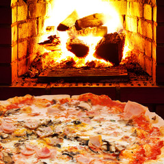 pizza with ham, mushroom and open fire in oven