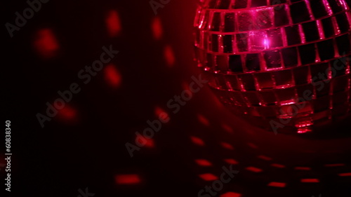 Dark background and disco ball. Seamless loop