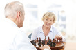 Senior Couple Playing Chess Together