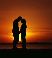 silhouette of a man and women fell in love