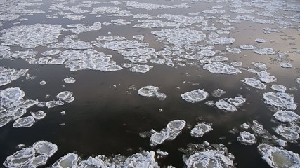 lot of ice floes on the icy river.