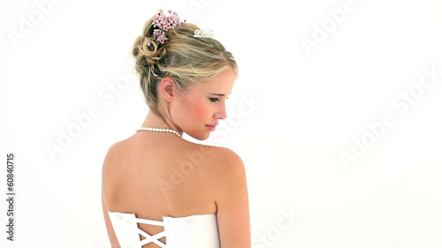 Blonde bride turning to smile at camera