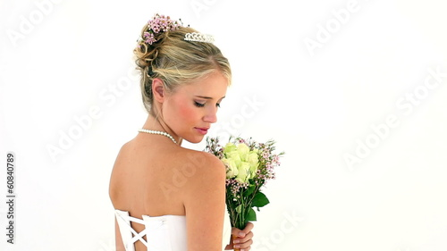 Blonde young bride turning to smile at camera