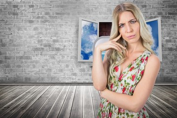 Composite image of frowning pretty blonde wearing dress