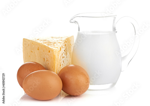 Big piece of cheese, glass jug with milk