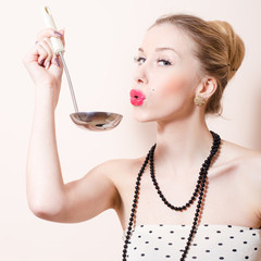 Happy pinup woman with ladle