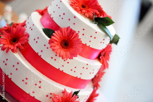 White wedding cake for a groom and bride